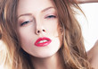 Beautiful woman's purity face with bright red lips make-up