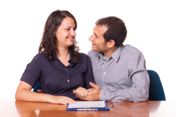 Happy Young Couple with Important Document to Sign