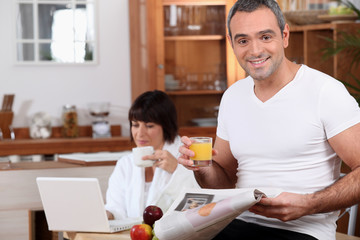 Couple enjoying breakfast together before work