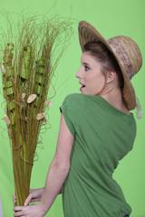 Woman admiring green plant