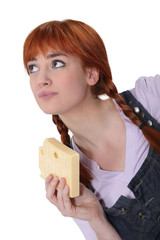 Woman with a block of Swiss cheese