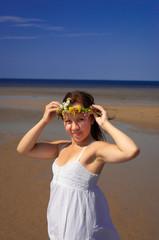 The girl holding a wreath on a head