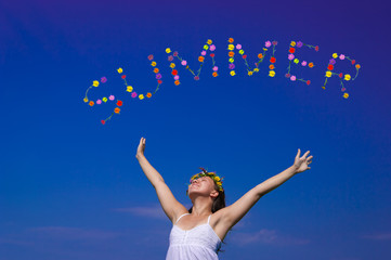 "woman throwing flowers in shape of word ""summer"""
