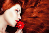 beautiful girl with gorgeous red hair.