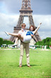Closeup of happy positive couple having fun near the Eiffel towe