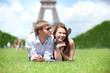 Closeup of happy positive couple laying on the grass in Paris
