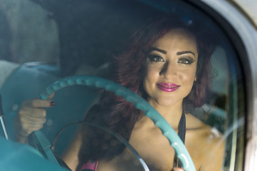 Woman driving car happy