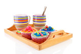 Tray with colorful decorated cupcakes and cup of coffee poster