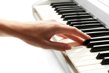 hand of woman playing synthesizer