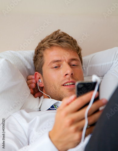 portrait of a businessman with music player smartphone