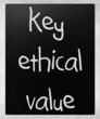 """key ethical value"" handwritten with white chalk on a blackboard"