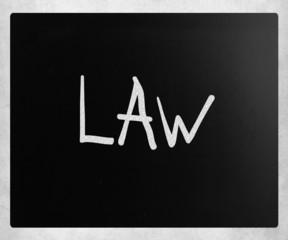 """""""Law"""" handwritten with white chalk on a blackboard"""