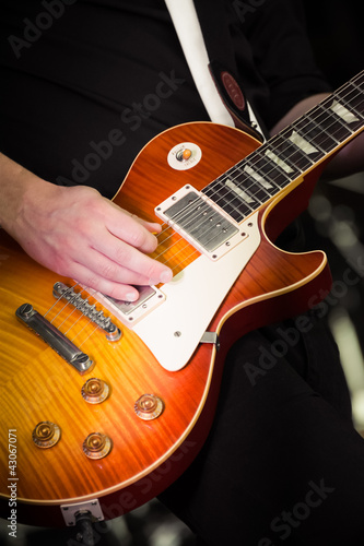 close-up of a musician playing an electric guitar