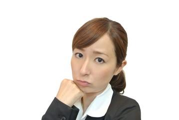 困った女性の顔