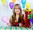 Birthday. Attractive young girl with gifts and balloons