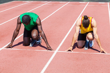 Two Track and Field Athletes before the Race Start
