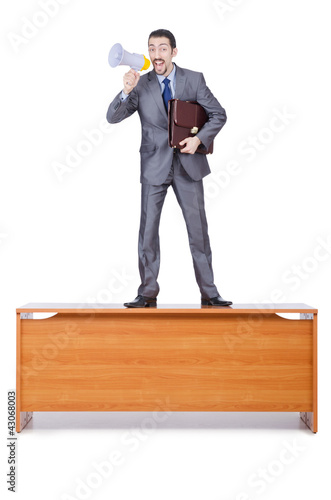 Businessman with loudspeaker at the desk