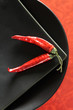 Chili pepper pods on  black plates