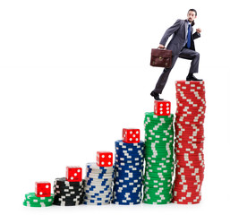 Businessman climbing stacks of casino chips