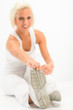 Woman stretch leg white fitness exercise