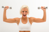 Cheerful fitness woman lift dumbbells isolated white