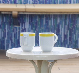 Two Coffee Cups on White Table