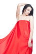 Beautiful lady in red sateen posing over white background