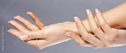 Woman hands on grey background, isolated