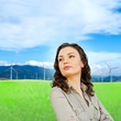 Pretty woman standing at beautiful countryside background. Natur