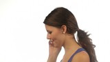 Young woman talking on the phone isolated
