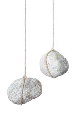 Stone hanging by a string on white