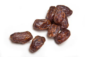 Medjool dates isolated on a white studio background.