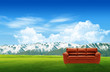 Red sofa on a green landscape