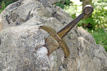 the legendary sword of King Arthur stuck in the rocks