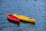 Two fiberglass kayak boat floating on water