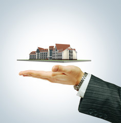 Hotel building  in businessman's hand
