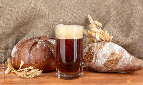 glass of kvass with bread on canvas background close-up