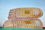 Reclining Buddha footprint with symbols imprinted on soles poster