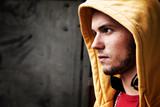Fototapety Young man portrait on graffiti grunge wall