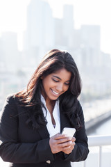 Indian businesswoman texting on the phone