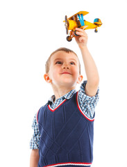 Cute little boy playing with a toy airplane