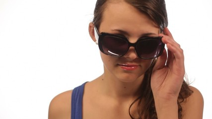 Young woman with sunglasses isolated