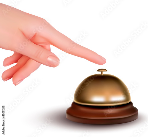Hand ringing the bell to call. Service desk