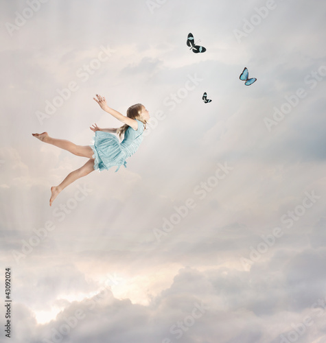Little Girl Flying at Twilight