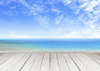 Wooden terrace looking out over a tropical cloud sky and seaview