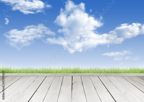 Wooden terrace looking out over a tropical cloud sky
