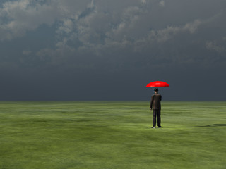 Man with red umbrella under gathering storm