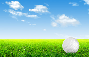 Close-up of golf ball with green grass for web design background