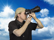 Man held camera against blue sky
