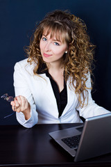 business woman sitting at desk and working